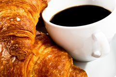 Breakfast with cup of black coffee, croissants Royalty Free Stock Photo