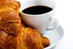 Breakfast with cup of black coffee and croissants Stock Photography