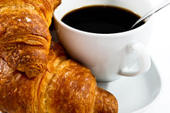 Breakfast with cup of black coffee and croissants Royalty Free Stock Image