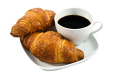 Breakfast with cup of black coffee and croissants Stock Image