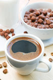 Breakfast with cup of coffee and chocolate flakes. Coffee and chocolate flakes with milk for a breakfast Stock Images