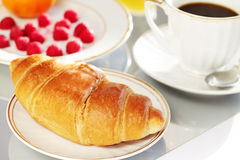 Breakfast. A cup of coffee and croissant Royalty Free Stock Photography