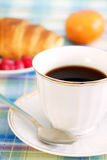 Breakfast. A cup of coffee and croissant Royalty Free Stock Photos