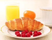 Breakfast. A cup of coffee, croissant Royalty Free Stock Image