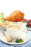 Breakfast with cup of coffee, croissants and berries Royalty Free Stock Image