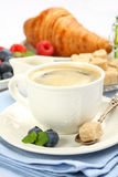 Breakfast with cup of coffee, croissants and berries Stock Photos