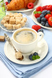 Breakfast with cup of coffee, croissants and berries Stock Images