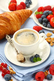 Breakfast with cup of coffee, croissants and berries Royalty Free Stock Images
