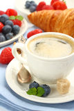 Breakfast with cup of coffee, croissants and berries Royalty Free Stock Photo