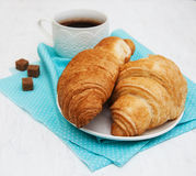 Breakfast. Cup of coffee and croissants on an old white table Royalty Free Stock Photography