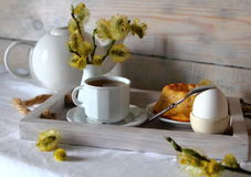 Breakfast with a Cup of tea,a cupcake. Egg and willow Royalty Free Stock Images