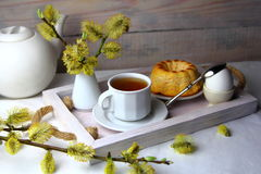 Breakfast with a Cup of tea and willow. Spring Breakfast with a Cup of tea,a cupcake,egg and willow Royalty Free Stock Image
