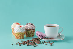 Breakfast with cupcakes and french macaroons Royalty Free Stock Photography