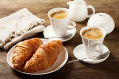 Breakfast with cups of coffee and croissants stock photography