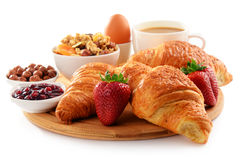 Breakfast on the cutting board on white Royalty Free Stock Photos