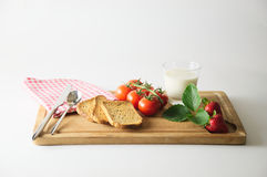 Breakfast on cutting boards Royalty Free Stock Image