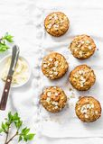 Breakfast dairy free muffins. Whole grain mini muffins with dried apricots, oatmeal, apple, carrots and nuts on light background. Top view Stock Images