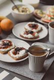 Breakfast with dark bread with white cheese and jam Stock Photos