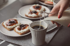 Breakfast with dark bread with white cheese and jam Royalty Free Stock Photos