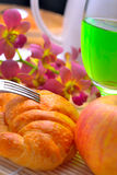 Breakfast delicious apple croissant bread green water in morning Royalty Free Stock Image