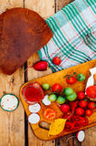 Breakfast, delicious sandwiches with cheese and tomatoes on a wooden background, view from above. Rustic food style. Breakfast. Fo Stock Images