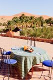 Breakfast in the Desert on the roof. Breakfast in the early morning near the sand dunes Royalty Free Stock Photography