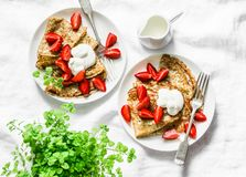 Breakfast, dessert table - crepes with strawberries and cream on a white background, top view. stock images