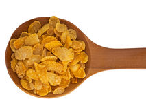Spoonful of cornflakes isolated over white background Royalty Free Stock Image