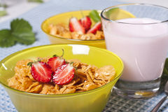 Breakfast. Dietary breakfast from flakes with strawberry and milk Stock Photos