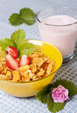 Breakfast. Dietary breakfast from flakes with strawberry and milk Royalty Free Stock Photos