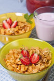 Breakfast. Dietary breakfast from flakes with strawberry and milk Royalty Free Stock Photo