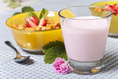 Breakfast. Dietary breakfast from flakes with strawberry and milk Royalty Free Stock Image