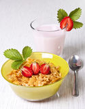 Breakfast. Dietary breakfast from flakes with strawberry and milk Royalty Free Stock Photography