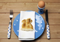 Breakfast dinner table setting with Easter bunny rabbit toast Royalty Free Stock Photos