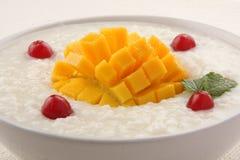 Breakfast dish -Mango rice pudding. Stock Photo