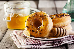 Breakfast with donuts and honey Stock Photos