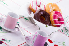 Breakfast with donuts Royalty Free Stock Images