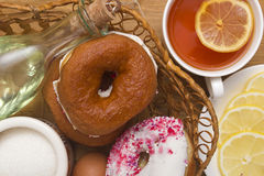 Breakfast of donuts and tea Royalty Free Stock Photo
