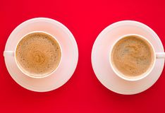 Hot aromatic coffee on red background, flatlay stock photo