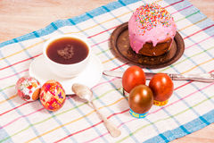 Breakfast on the Easter eggs and small Easter cake Stock Photo