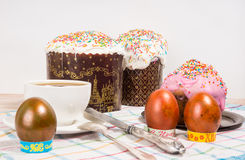 Breakfast on the Easter eggs and small Easter cake Stock Photography