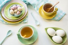 Breakfast with Easter eggs, tea and candy stock image