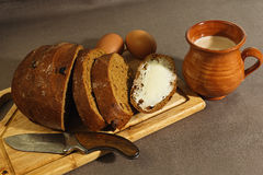 Breakfast in eastern european traditional style. Breakfast made of rye bread with butter, homemade yogurt and eggs on an old cutting board with rural styled stock photo