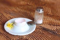 Breakfast. Eaten egg with spoon and salt Stock Image