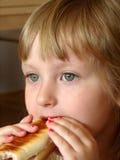 Breakfast / eating sendwich Stock Photography