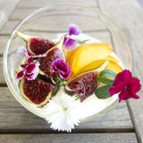 Breakfast with edible flowers Stock Photos