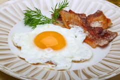 Breakfast - egg with bacon Stock Images