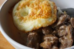 Breakfast with egg and beef. A bowl of the breakfast menu with beef and eggs close up and delicious looks detail of its food Stock Photo