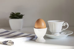 Breakfast with egg and coffee. On white table,Modern style Royalty Free Stock Photo