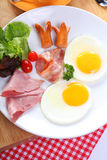 Breakfast with egg, ham, bacon, sausage Royalty Free Stock Images